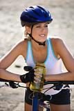 Young woman bicycling.