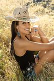 Young woman wearing straw cowboy hat.