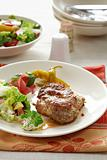 Steaks with mixed salad