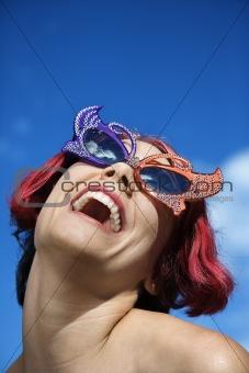 Adult female wearing unique glasses.