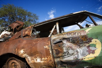 Old abandoned and rusted car.