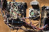 Wires and old broken electrical car components.