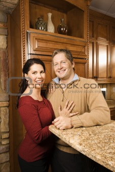 Portrait of man and woman in kitchen.