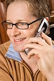 MId-adult male talking on cellphone.