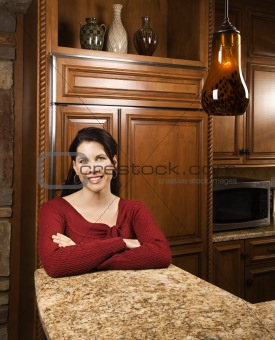 Portrait of mid-adult female in kitchen.
