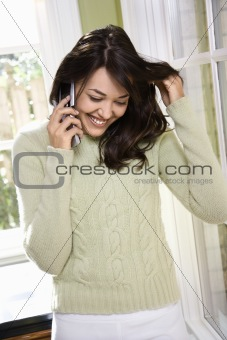 Woman talking on cell phone.