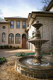 Outdoor front view of home with fountain.