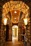 View of foyer through stone archway in affluent home.