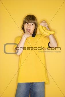 Caucasian boy with bananas.