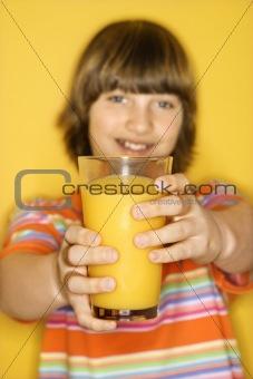 Caucasian boy with glass of orange juice.