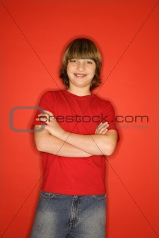 Caucasian boy with arms crossed.