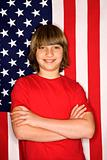 Caucasian boy against American flag.
