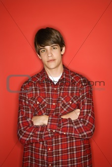 Caucasian teen boy with arms crossed.