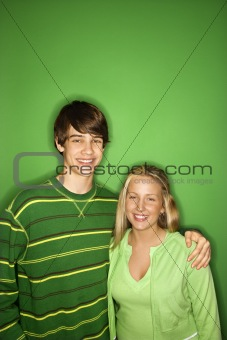 Portrait of Caucasian teen boy and girl.