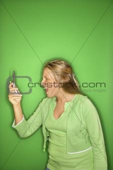Caucasian teen girl with cellphone.