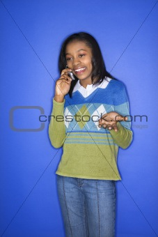 African-American teen girl talking on cellphone.