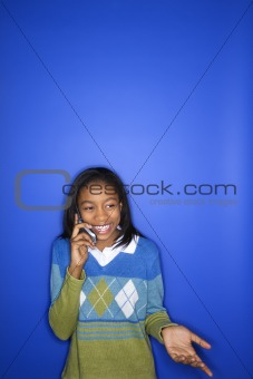 African-American teen girl talking on cellphone.