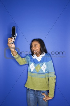 African-American teen girl with camera phone.