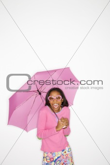 African-American teen girl holding pink umbrella.