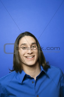 Portrait of Asian-American teen boy smiling.