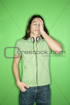 Asian-American teen boy with headphones.