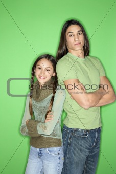Asian-American girl and teen boy back to back.