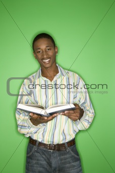 African-American teen boy with book.