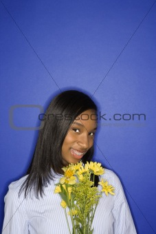 African-American teen girl with flowers.