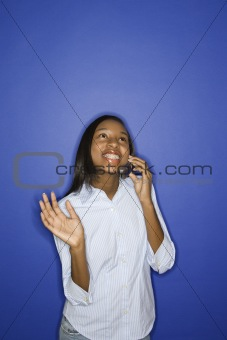 African-American teen girl on cellphone.