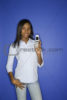 African-American teen girl holding cellphone.