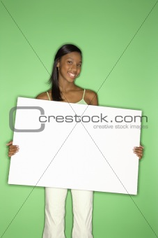 African-American teen girl holding blank white board.