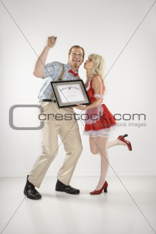 Young man cheering and receiving certificate from young  woman.