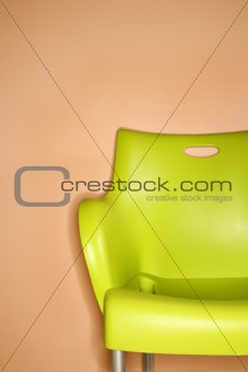 Green chair against wall.