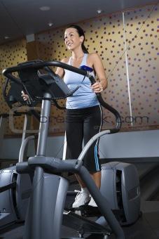 Adult female on elliptical machine.