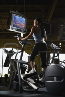 Adult female on elliptical machine