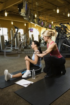 Adult female with personal trainer.
