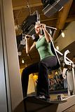 Adult female using exercise equipment.