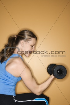 Adult female lifting hand weights.