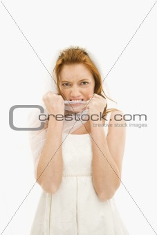 Bride biting her veil.