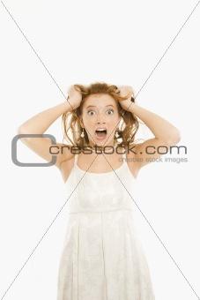 Bride pulling her hair.