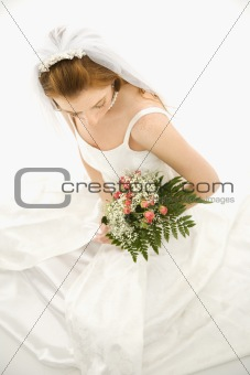 Bride holding bouquet.