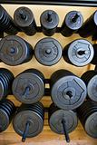 Stacks of barbell weights at gym.