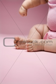 Close up of babys legs and arm.