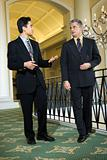 Two businessmen in hotel.