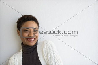 Adult woman looking at viewer and smiling.
