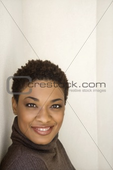 Adult woman looking at viewer smiling.