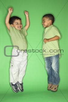 Boys jumping.
