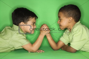 Boys arm wrestling.