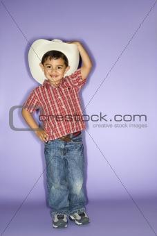 Boy wearing cowboy hat.