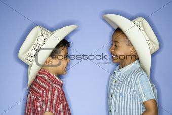 Boys wearing cowboy hats.